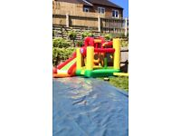 Bouncy castle with slide and games area comes with blower