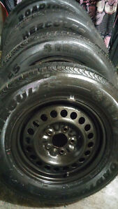 Almost Brand New Hercules 215 70 15 tires 0n PontiacMontana Rims