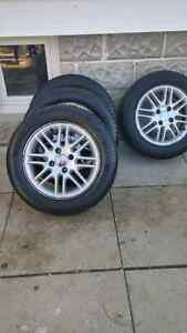 Set of ford focus rims and tires
