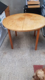 Light oak style round dining table