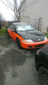 2001 chev cavalier 2 sets tires and rims $2500