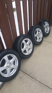 Four 5X114.3 or 5X100 rims with tires