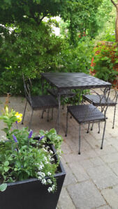 Wrought iron and wood out door breakfast set.