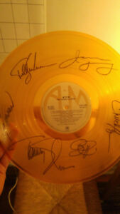 Signed Grand Illusion Album by Entire Band