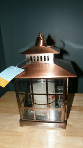 NEW COPPER-COLOURED METAL LANTERN WITH CANDLE