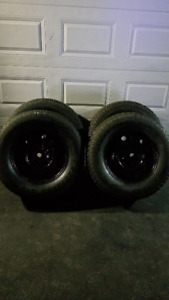 4 Good condition Studded Winter tires on rims