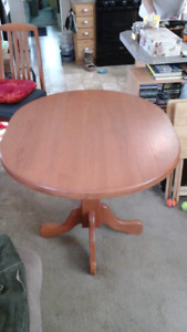 Oak pedestal dining table and chairs