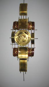 Metal Sculpture - hungs on a wall.