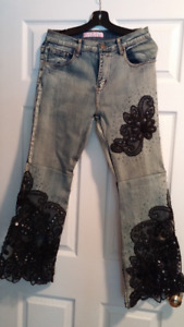 HIPPIE PANTS WITH BAG OF BEADWED NECKLACES FOR COSTUME