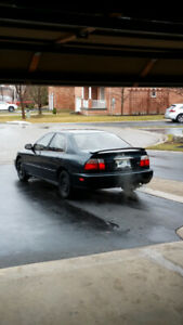 Honda SOHC 2.2 L 1997 Accord EXR with factory trunk spoiler. 4dr