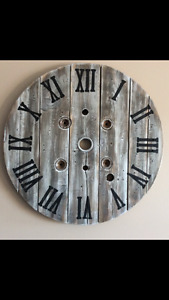 Beautiful custom cable spool clocks