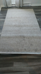 Brand new 6' by 11' carpet and top quality underlay