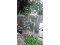 Small glass & metal greenhouse