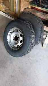 2   15 inch winter Studded tires with rims