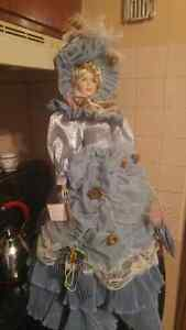 Porcelain Doll 30 inches high 20.00