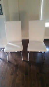 ASHLEY DINNING CHAIRS NEVER USED