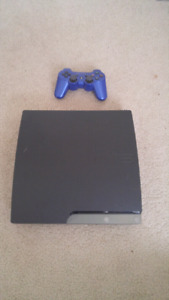 PlayStation 3 slim with games and controller.