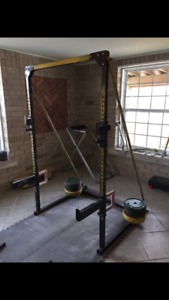 Half rack/barbells/plates/totalgym/adjustable bench
