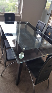 Glass Dinning Table with 6 chairs for Sale