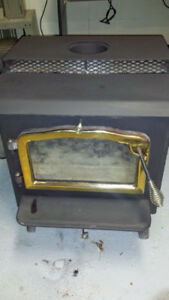 ***HERITAGE WOOD STOVE LIKE NEW***