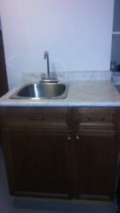 Kitchenette Sink and Cupboards