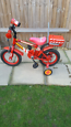 Boys Fireman toddler bike with stabilisers