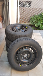 4 Dodge Caravan 2012 Wheels 16'' with Tiger Paw Tires 215/65R16