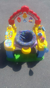 Exersaucer - Great Condition- EXTRA toys on it! Will deliver