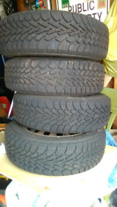 4 Goodyear Nordic Winter tires & rims