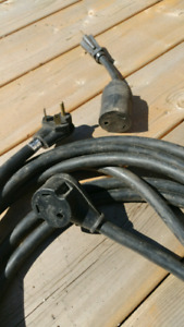 30 amp RV EXTENSION CORD. 25 Ft. With 15 amp adapter.