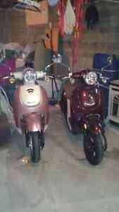 2 Honda scooters 2013 and 2014