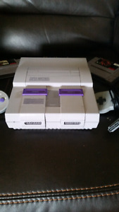 Perfectly working  (ON HOLD)   nintendo snes with games