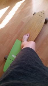 Longboard  / planche à roulettes