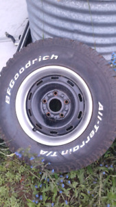 Ram rims with trim rings ok shape tires are 35 % left hold air