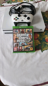 Xbox one s 1tb plus one games