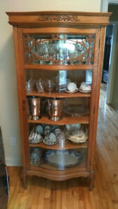 Beautiful antique Oak display cabinet with curved glass door.
