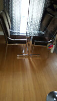 Early 80's glass dining table and chairs