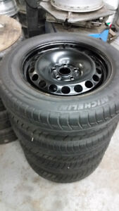 Used 215 60 16 Michelin XIce on OEM chevy Cruze rims 5x105 TPMS