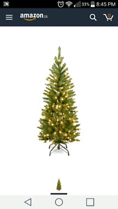 4.5 foot Christmas Tree with 150 clear lights.