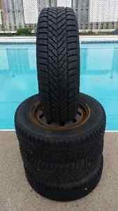 4 Goodyear Ultra Grip Ice on Rims (4 holes) P195/70R14