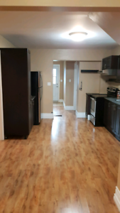 2 bedroom - main floor of century home with yard and deck.