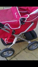 Girls silver cross toy buggy with tray and bag.have box in loft.minimum use brentwood collect £20!