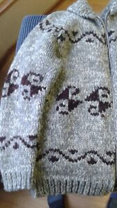 Hand made used sweater.  21 inches wide.  30 inches long.