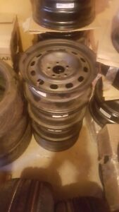 New Rims, Valve stems included   Set of 4