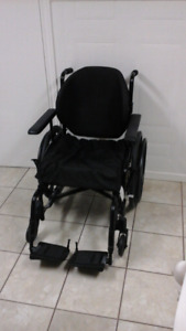 Invacare Foldable Wheelchair and ROHO Air Cushion
