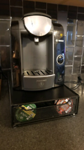 Tassimo for sale with disc storage and pack of coffee discs