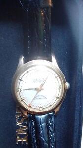 telix gold watch   new band