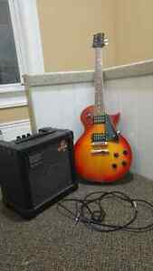 Jay Turser guitar and Rolan amp