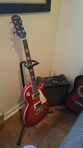 Gibson Les Paul and spanish acoustic and Roland Amp