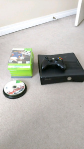 Xbox 360 with games and steering wheel
